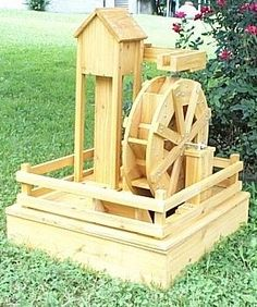 Water Crafts' builds and sells water wheels, water wheel fountains and lawn water mills: