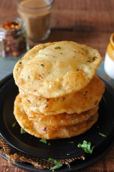 indian food Masala Cheese Puri is a delicious Indian breakfast loaded with cheese, herbs, and paneer. Learn how to make cheese puri in a few simple steps. Indian Veg Recipes, Indian Snacks, Vegetarian Recipes, Snack Recipes, Cooking Recipes, Cooking Herbs, Vegetarian Cooking, Healthy Recipes, Puri Recipes
