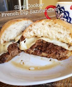 Slow Cooker French Dip http://www.raraandaggie.com/guilty-pleasures/slow-cooker-french-dip-sandwiches/