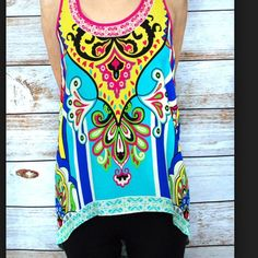 "HOST PICK!! Sleeveless high low tank NWOT MULTICOLORED Tribal pattern. 100% rayon. Silky feel and lightweight. The front rise is 25"" and the back is 32"". Brand new. Never worn.  Retail purchased. I believe the tag is loose in the bag. Flying Tomato Tops Tank Tops"