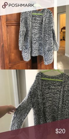 Torrid Plus Size Fuzzy Knit Grey Cardigan Fuzzy grey (black/white combo) cardigan. Has two pockets in the front. Size 2, or 2x. Tag was removed because it was itchy. Purchased three or four years ago. Some parts are 'fuzzier' than others. Price reflects age. In great condition regaurdless.   Please zoom in to see details. Feel free to ask any further questions!   I'm open to negotiate through the offer feature; I'm studying abroad and need to sell all of these treasures I've neglected to…
