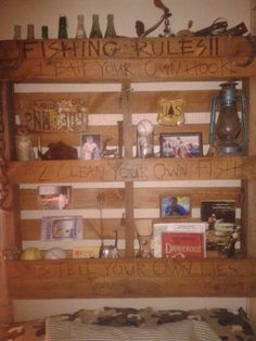 Headboard shelfing made from an old pallet.  Woodburned and stained.  SrS   #pallet #woodburn #fishing