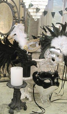 Throw a couple masks in with table decor to add some pretty to the creepy. Also, people can wear them eventually