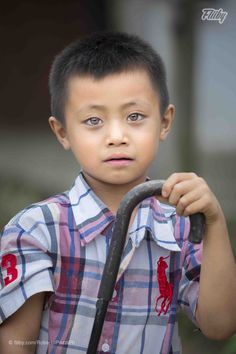 Amazing portrait photograph from RobertoPazziPh of a young boy taken in Laos  https://fliiby.com/file/i36c832i0q6/?utm_content=bufferc8540&utm_medium=social&utm_source=pinterest.com&utm_campaign=buffer #portrait #photo