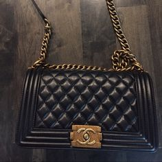 Black cross body or shoulder handbag High quality lambskin. Very soft. The clasp is a little tricky but works. The gold chain is antique gold not as light as in pictures. Very good look a like.! Brand new, used once. Medium size. Bags Crossbody Bags