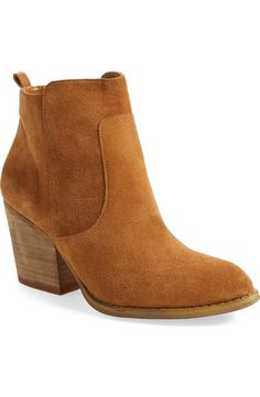 73ab30ac6305 A clean-cut and effortlessly versatile suede ankle bootie set on a stacked  block heel