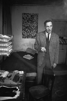 FRANCE. Paris. The American writer William S. BURROUGHS, living in his small 'Hotel Le Vieux Paris' on the Rue Git Le Cœur on the Left Bank. 1970.  (Nicolas Tikhomiroff)