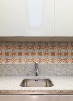 Just because it's a rental doesn't mean you can't help it out. Tyles Alhambra on the kitchen backsplash in this rental apartment. http://tyles.co/collections/traditional/products/tyles-alhambra-in-warm-grey-and-orange