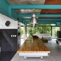 Love the exposed beams - Nitsche Arquitetos Associados designed this house in Iporanga, Guarujá, SP, Brazil