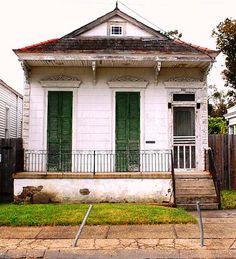 "New Orleans Tiny House - The ""gingerbread"" over the narrow shuttered windows is awesome."