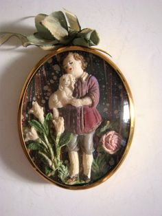 Miniature sugar paste picture of boy and dog