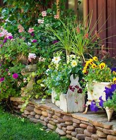 """I love finding items that can be turned into planters—from cast-stone frogs and a wine barrel to watering cans that I've painted red and a pedestal sink,"" she says. Here, a vintage wood toolbox filled with border dahlia and dwarf maiden grass is nestled against an old cast-iron stove with pansies and petunias tumbling out.  #garden #gardendesign #gardenideas #gardendecor #homeimprovement #gardentour Landscape Design, Garden Design, Container Herb Garden, Recycling Containers, Homestead Gardens, Growing Gardens, Cast Stone, Better Homes And Gardens, Raised Garden Beds"
