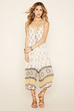 f392c1ba394e A crinkled woven culottes jumpsuit by Raga trade  featuring an allover  ornate print