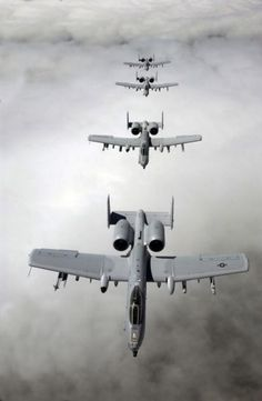 Four A-10 Thunderbolt II aircraft in formation