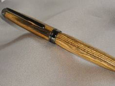 Handmade writing utensil. AKA a wooden pen.