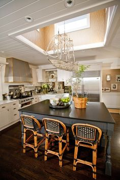 Not sure about the ship chandelier but love the look of just an elegant chandelier hanging like that in my kitchen!!!