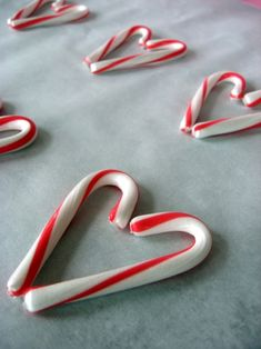 We do this every year with candy canes from Christmas.  Be sure and buy them right after the holiday - they are usually marked way down.  This is the only time of year I can find them,  Who knew?  Tie a red bow at the top.  You can do dozens and dozens.My daughter gives them away on Valentines.