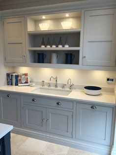 Tom Howley Altrincham showroom, sink area with Perrin & Rowe taps with spray. Quooker hot tap and mìele built-in dishwasher & pull out bin.