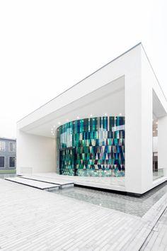 Modern circular wedding chapel in Shanghai operates inside a glass museum. Rainbow Chapel in the G+Park.