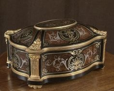 Maison TAHAN:  Jewel box in ebony and Boulle marquetry.