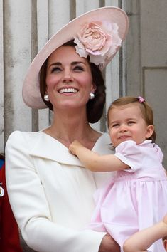 Catherine, Duchess of Cambridge and Princess Charlotte of Cambridge watch a fly past during the Trooping the Colour, this year marking the Queen's 90th birthday at The Mall on June 11, 2016 in London