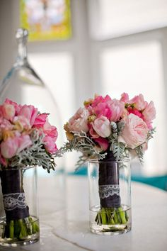 Pink bouquets with black ribbon + lace