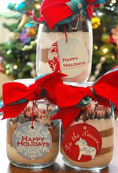 In each jar layer one cup powdered milk, one cup unsweetened cocoa, 3/4 cup sugar, 3/4 cup chocolate chips, 3/4 cup round peppermint candies (or crushed peppermint candy canes). To enjoy, mix cocoa in a large bowl and add 1/3 cup mix to a mug, fill mug with hot water.