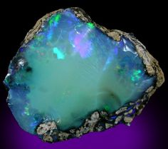 Opal is my birthstone and I always hated it...I've never seen it like this though!  Beautiful