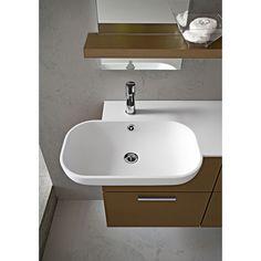 Arredo bagno con lavabo semincasso Dixi Aquna 57. Piano in resina Tecnoril e base con cestoni. Originale lavabo a sbalzo laterale.
