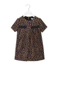 Printed Crepe Flared Dress sizes 2 - 6  $149.00  Super fun. Super cute. Animal printed round collar A-Line dress features front and back pleats, a contrast front band, and signature LMJ logo embroidery.    #W12007-1