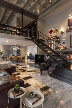 Modern Great Room with Exposed beam, stone tile floors, Box ceiling, Columns, onyx tile floors, Paint, High ceiling, Paint 2 Loft Staircase, Staircase Ideas, Stairs, Man Of The House, Room Interior Design, Interior Design Inspiration, Interior Decorating, Loft Spaces, Living Area