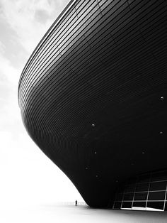Black and white photographs of Zaha Hadid's London 2012 Aquatics Centre by photographer Luke Hayes