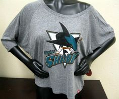 Stay fashionable and support the San Jose Sharks with this off the shoulder t-shirt! Get all the latest Sharks gear at the Sharks Store at HP Pavilion