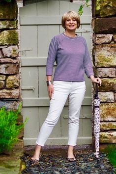 What to wear when it rains in the summer - these clashing monochrome patterns add a bit of interest to cropped frayed jeans. Midlifechic is a UK style blog for women over 40.
