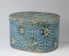 Antique Wallpaper box~Image via Northeast Auctions. http://northeastauctions.com/product/large-wall-paper-covered-box-with-floral-motif-on-a-blue-ground/