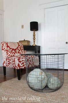 Cute table idea from The Mustard Ceiling blog. That looks like the Utilitarian Basket from Barn Light Electric!