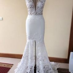 Here is a cap sleeve sexy lace wedding gown by Darius. This v-neck bridal dress has a front split on the skirt. The back has a v opening as well and is backless. Have this bridal gown made with any design preferences.  If your dream dress is more than you want to spend we can also make a close #replica of that dress for you that will cost much less. Get pricing and details on custom wedding dresses & replicas at www.dariuscordell.com