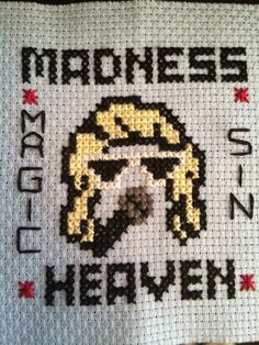 Taylor Swift cross stitch I made for an ornament I gave as a Christmas present