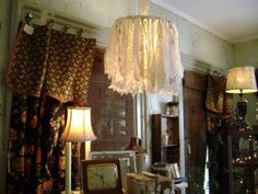 strips of muslin and lace hung from lamp shade frame