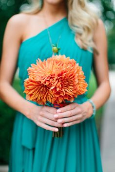 .bridesmaid color dress and orange flowers! PERFECT!