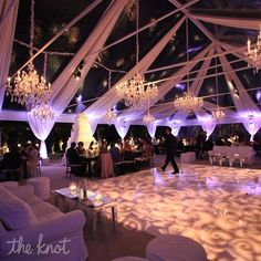 """The best way to wow guests is to let the beauty of nature take over,"" says Sacks. ""Plus, it costs nothing."" To create the feeling of dining under the stars, she draped the ceiling with white chiffon that opened up to the sky.  from the album: A Sophisticated Wedding in Santa Barbara, CA"
