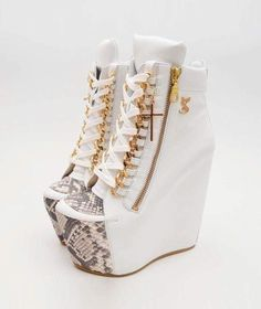 Anklet boots with Zipper, Laces and open tooth. http://www.allthingsvogue.com