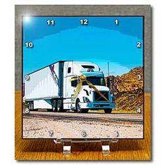 A big truck driving downer the road near Diamond Valley, Utah Desk Clock