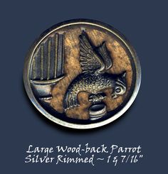Very Large 19th C. Wood-background Parrot Button ~ R C Larner Buttons at eBay  http://stores.ebay.com/RC-LARNER-BUTTONS