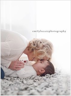Emily Lucarz is a newborn and family photographer in St. Louis Missouri. She specializes in family photography. Call her at 314-915-2010 to book .