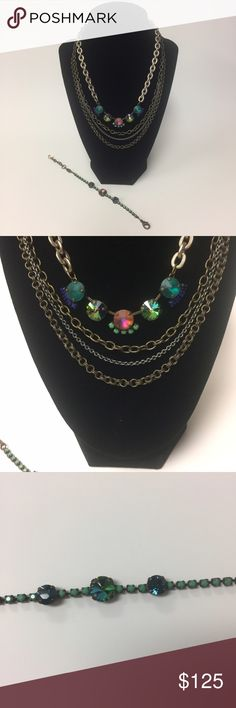 Sabika Necklace Set and Bracelet Sabika three row chain necklace, a five stone necklace and a matching bracelet. Beautiful green stones on the necklace and bracelet. Sabika Jewelry
