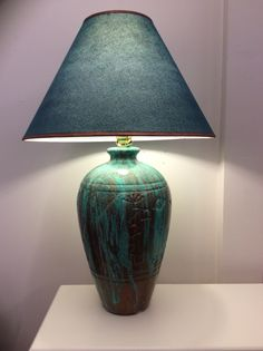 Ceramic lamp base painted with Modern Masters Metal Effects copper and blue patina.