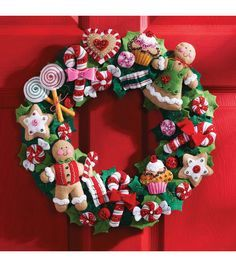 Decorate your home for the holidays with this beautiful seasonal wreath. This kit contains everything you need to make one 15-inch wreath with candy decorations. Included are: stamped felts; cotton fl