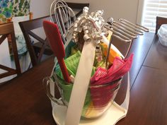 Start with a Pampered Chef batter bowl, added some kitchen towels, dishcloths and gadgets.   www.pamperedchef.biz/LeanneJ