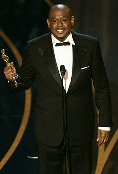 """Forest Whitaker accepts his Oscar for lead actor for his performance as Idi Amin in """"The Last King Of Scotland."""""""